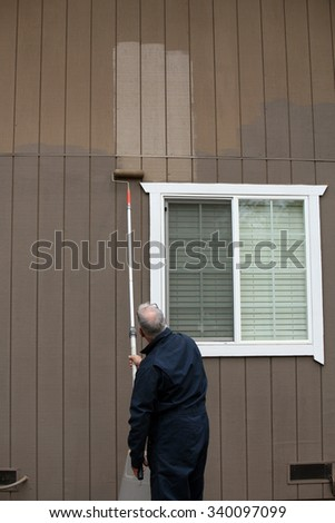 Painting a house outside - stock photo