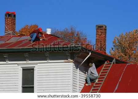 Painting a tin roof on an old house