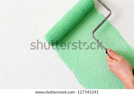 painting a wall - stock photo