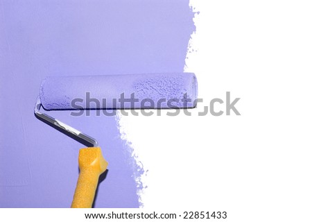 painting a wall with a roll in purple
