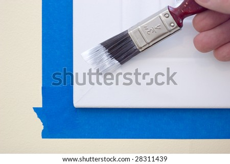 Painting a window trim or molding - stock photo