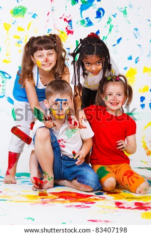 Painting activity keeping four kids busy - stock photo