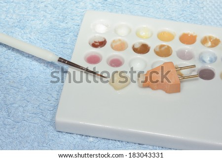 painting all-ceramic crown - stock photo