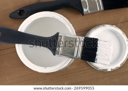 Painting and decorating top down view of a pot of white paint and brush - stock photo