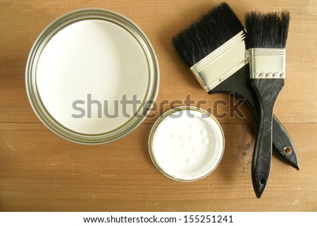 Painting and decorating  Top down view of a pot of white paint and brushes - stock photo
