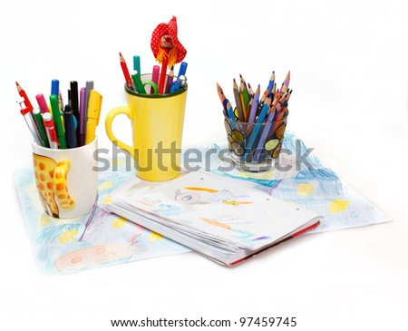 Painting  and pen holders  with colored pens on a white background - stock photo
