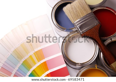 painting apartment! A lot of paint, paint cans, brush - stock photo