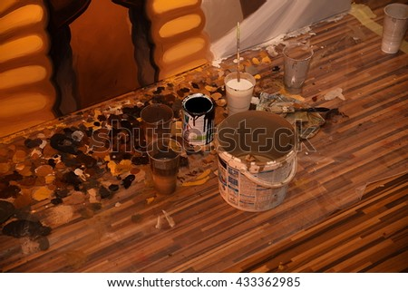Painting atelier and clutter on the table - stock photo