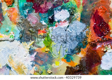 Painting backgrounds of oil color on the palette - stock photo