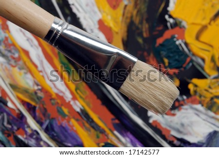 Painting brush over abstract colored background - stock photo