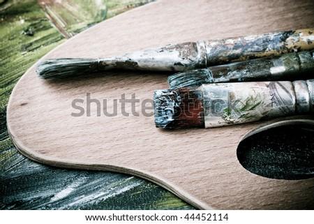 Painting brushes in artist studio - stock photo