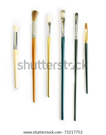 Painting brushes in real-life used condition, isolated on white. - stock photo