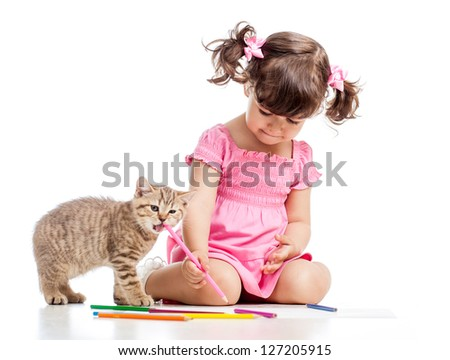 painting child girl with playful kitten - stock photo
