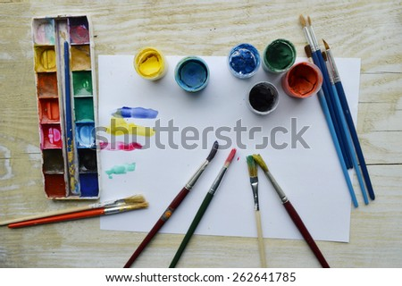 painting creativity on the wooden background - stock photo