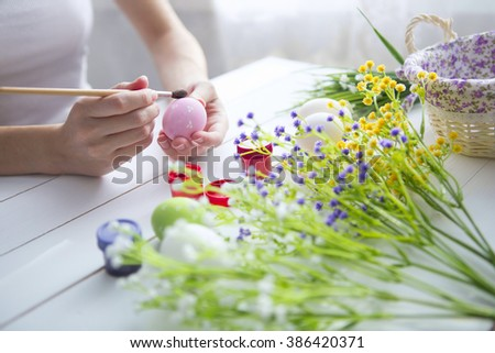 Painting Easter eggs. Painting eggs for easter holiday celebration. Happy easter - stock photo