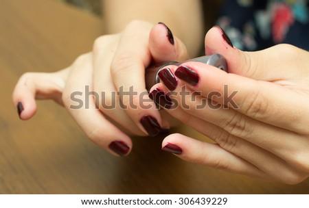 painting fingernails with varnish - stock photo