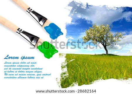 Painting landscape with paintbrushes with copyspace for your text - stock photo