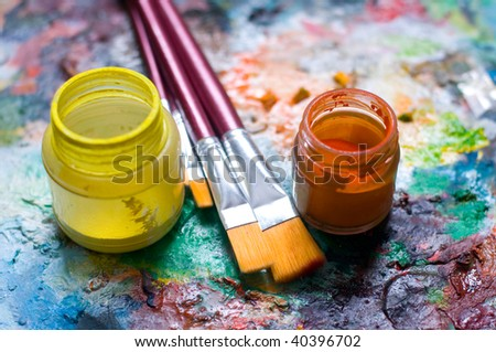 Painting material, brushes, oil pigment, focus on brushes, low deep of field - stock photo