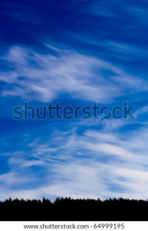 Painting of high contrast clouds over horizon of trees