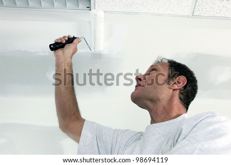 Painting office ceiling - stock photo