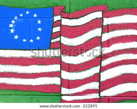Painting on building of American flag bearing original 13 colonies - stock photo
