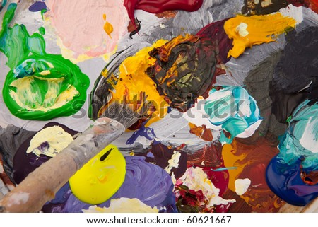 painting palette with paint color and paintbrush. abstract art creation - stock photo