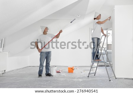 Painting roof and walls wallpaper - stock photo