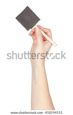 painting sponge in a hand isolated on white background. artist tool - stock photo