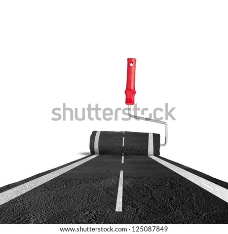 Painting the road with roller brush - stock photo
