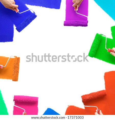 Painting the wall with colorful rollers - stock photo