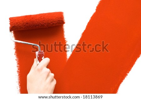Painting the wall with red roller - stock photo