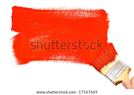 Painting the white wall with red paint - stock photo