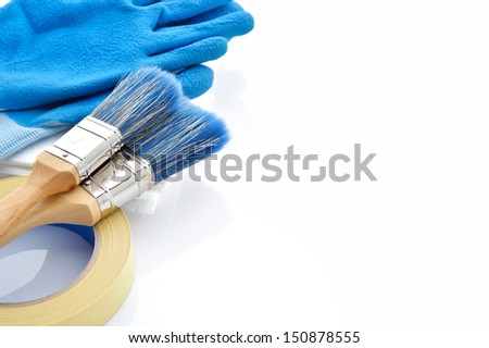 Painting tools on white background. Masking tape, brushes, drop cloth and gloves on white background. Plenty of copy space. - stock photo