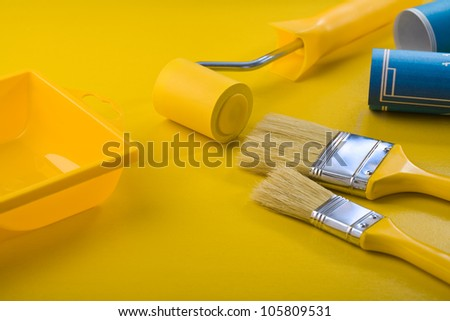painting tools on yellow table