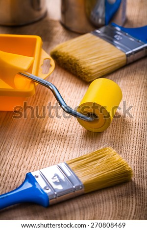 painting tools very close up view paint brushes roller tray can on wooden board construction concept  - stock photo