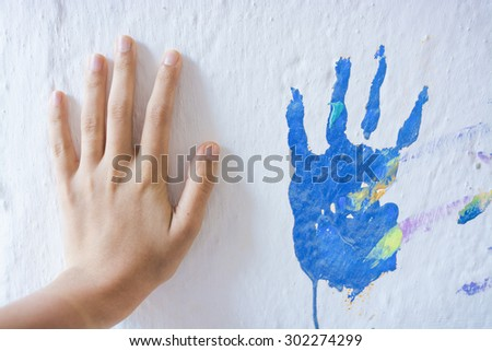 Painting wall with hands - stock photo