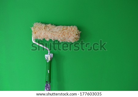Painting walls with a paint roller - stock photo