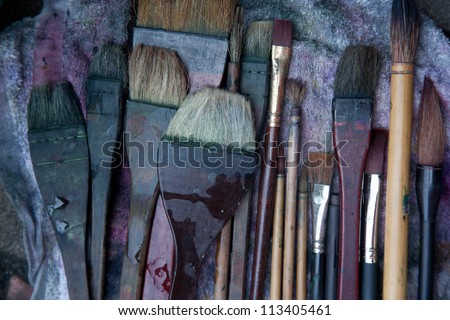 Painting with oil painting scrubbing brush - stock photo
