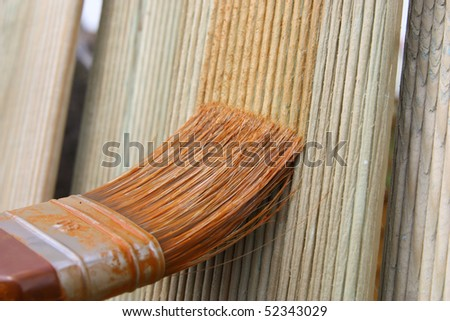 Painting wooden furniture piece - stock photo