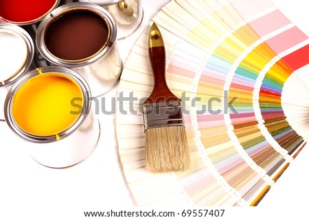 Painting Your Home! Paint cans and brush - stock photo