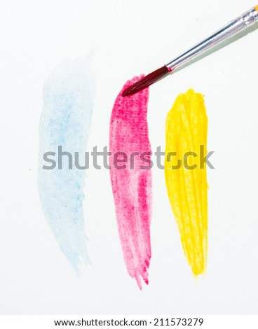 Paints and brushes color water on white background - stock photo