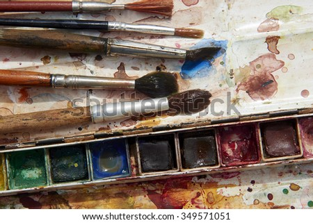Paints and childish painting equipment, Watercolors and brushes, Colorful water paint, water color paints - stock photo