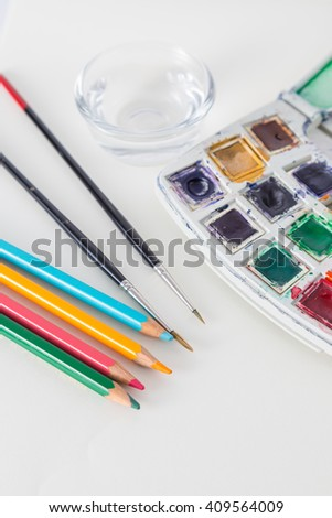 Paints and childish painting equipment, Watercolors and brushes, Colorful water paint, water color paints(selective focus) - stock photo