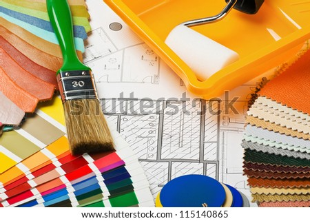 Paints, brushes and accessories for repair to architectural drawing.