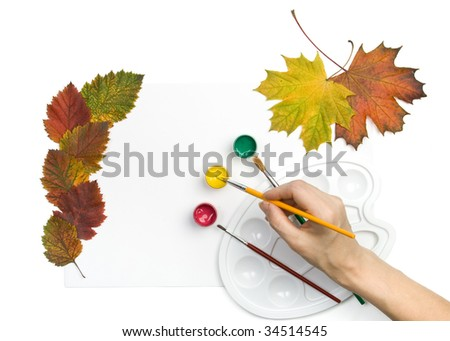 Paints, brushes and autumn leaves on a white background. We draw autumn. - stock photo