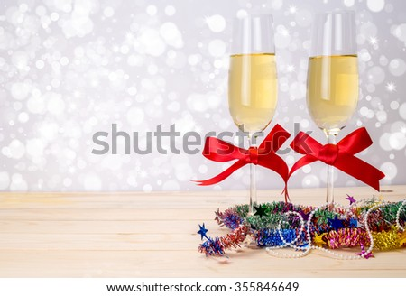 Pair glass of champagne. New year celebration with defocused lens blur over background. Celebration concept.