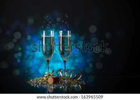 Pair glass of champagne with clipping path on blue background - stock photo