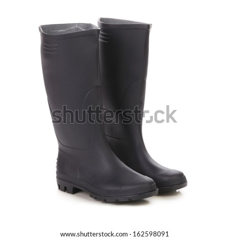 Pair high rubber boots. Isolated on a white background. - stock photo