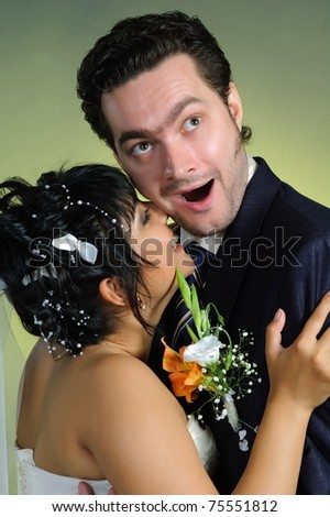 Pair newlyweds bridegroom and bride pose in studio - stock photo