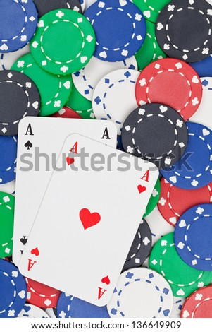 Pair of Aces on casino chips - gambling or poker concept - stock photo